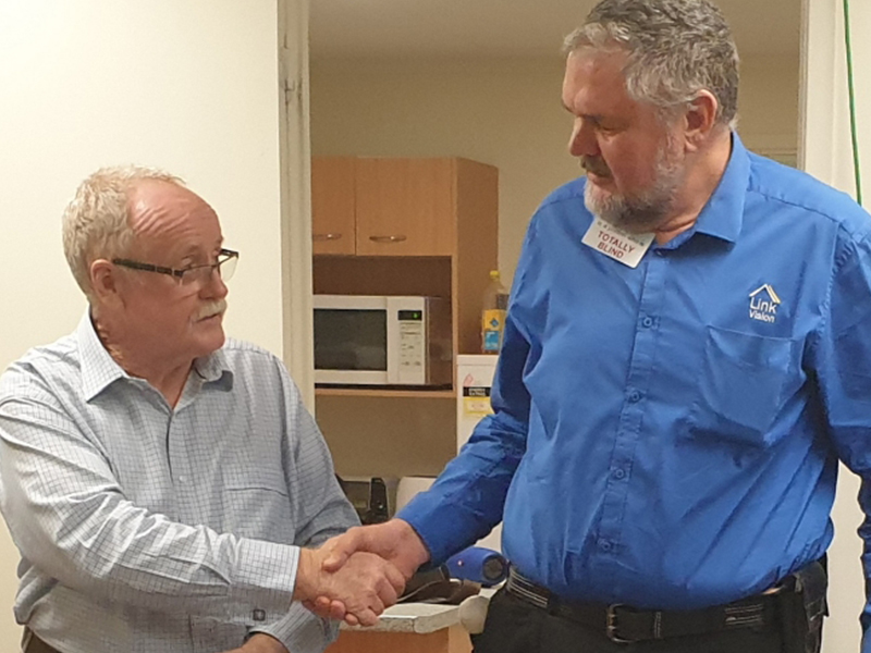 Arthur Chawner shakes hand with Link Vision CEO Terry Oneill